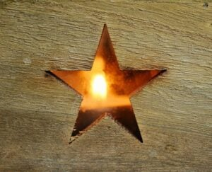 Wooden star with candle light