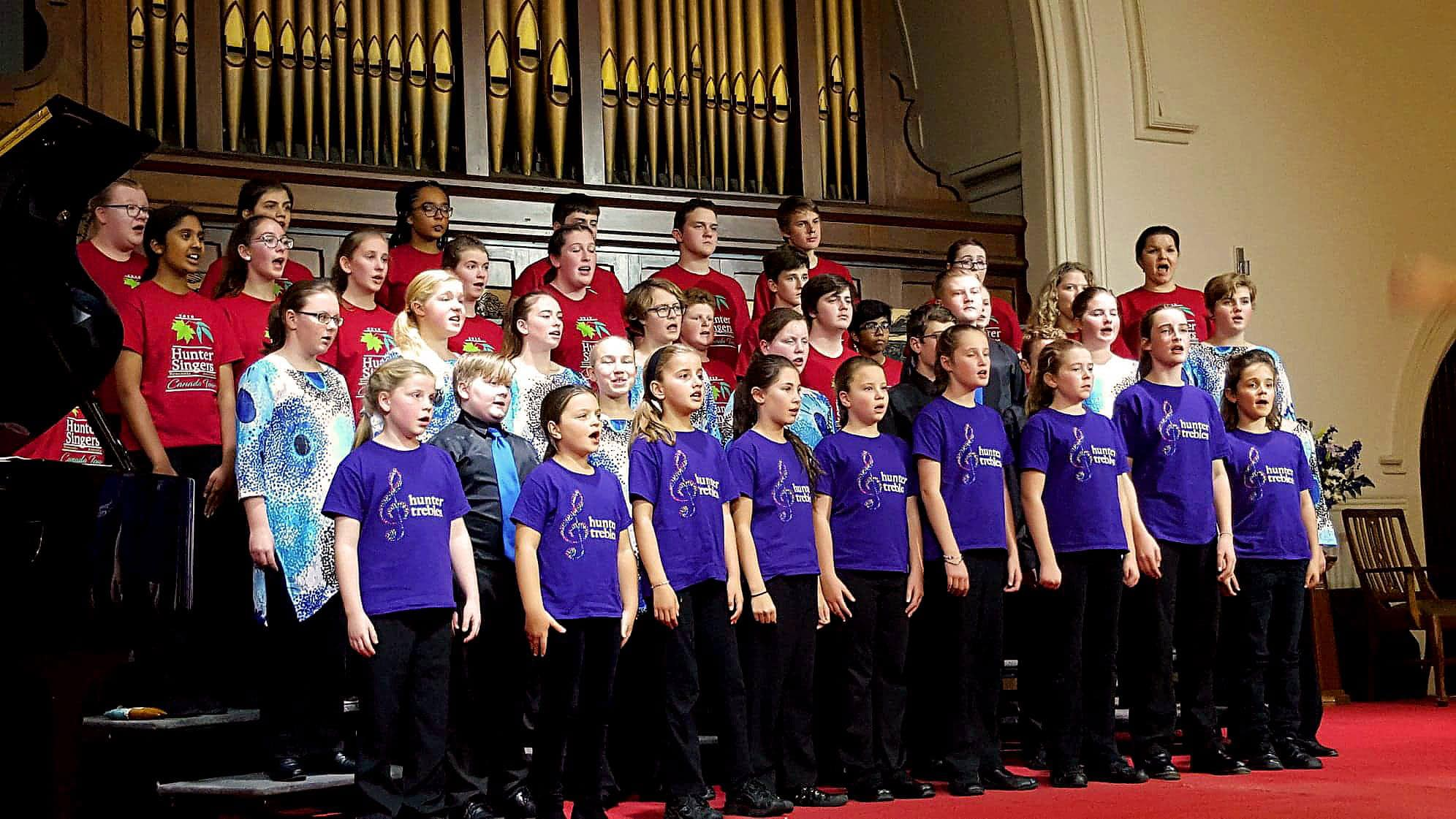 Hunter Singers and Hunter Trebles Choirs singing in concert