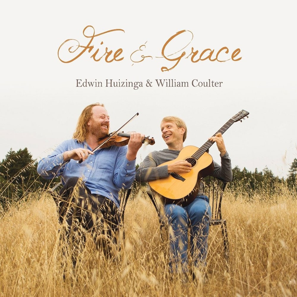 Fire and Grace music cover – 2 musicians playing a guitar and violin in a field